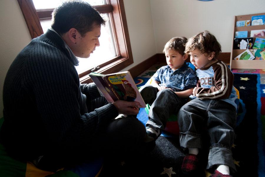 Ho-Chunk member Henning Garvin reads to Native American children